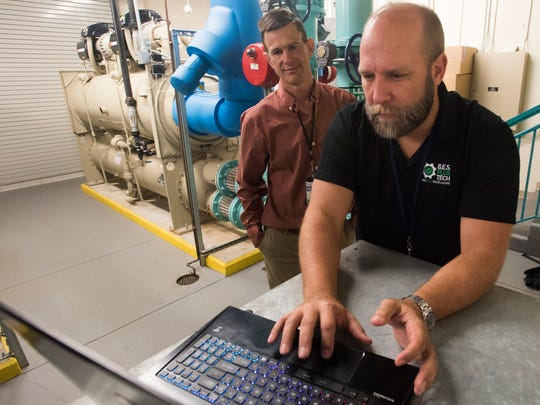 Roger McGraw, a Mechanical Engineer with the Escambia County School District, left, meets with Andy Heitman, of Building Energy Sciences, LLC,  to inspect the power and mechanical plant at A.K. Suter Elementary School Thursday, Oct. 19, 2017.