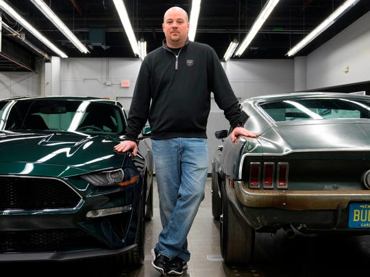 "Sean Kiernan of Nashville, Tennessee is the owner of the ""Bullitt"" car.  He is photographed with the 2019 Ford Mustang Bullitt on the left and the 1968 Ford Mustang Fastback from the 1968 movie Bullitt on the right."