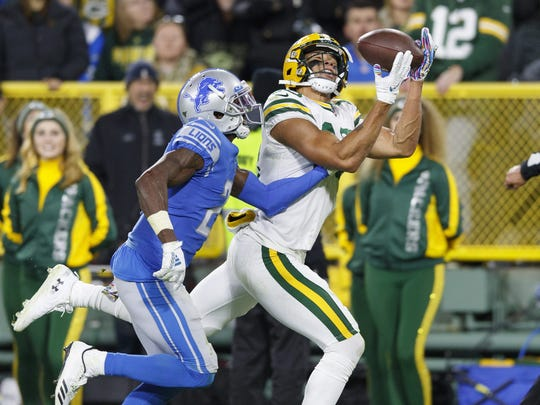Oct 14, 2019; Green Bay, WI, USA; Green Bay Packers wide receiver Allen Lazard (13) catches a pass to score a touchdown in front of Detroit Lions cornerback Justin Coleman (27) during the fourth quarter at Lambeau Field. Mandatory Credit: Jeff Hanisch-USA TODAY Sports
