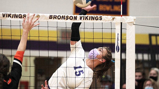 Bronson's Karissa Gest skies up high for one of her team high 10 kills versus Quincy Tuesday.