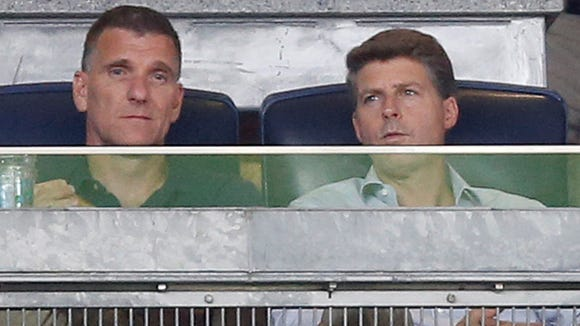 New York Yankees principal owner Hal Steinbrenner, right, watches the team's baseball game between against the New York Mets on Wednesday, Aug. 3, 2016, in New York.
