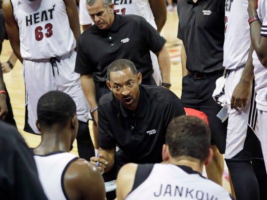 Miami Heat assistant coach Juwan Howard talks to players