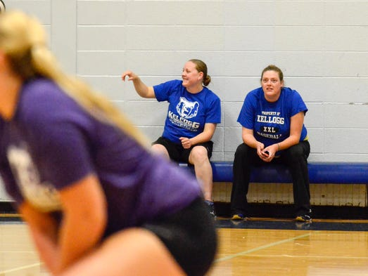 KCC Volleyball Head Coach Amy Julien (right) watches as the volleyball team practices Wednesday evening.