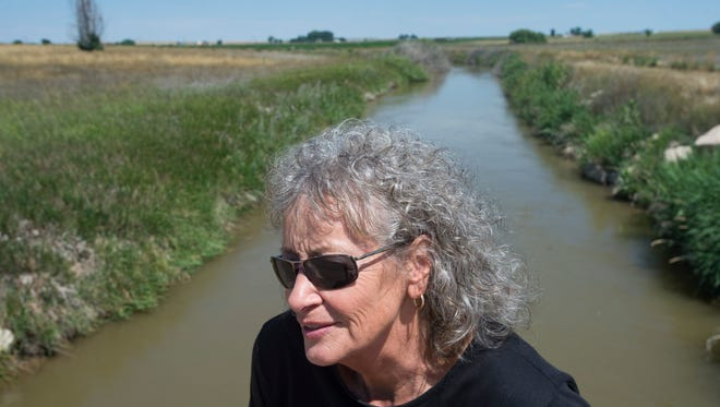Pierce Mayor Nansi Crom poses for a photo along the Collins Lateral irrigation ditch just outside of Pierce, Colorado on Tuesday, July 17, 2018.