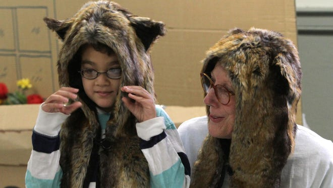 """Spencer Bailey and Sharon Griffith wear costumes during a performance of """"The Call of the Wild"""" by the autism-friendly production company Yellow Finch Project at the Westchester Exceptional Children's School in North Salem. Yellow Finch designed the play """"Bookmarks"""" — short and immersive adaptations of """"The Tale of Peter Rabbit,"""" """"The Call of the Wild"""" and """"Treasure Island"""" — to make kids on the spectrum (and their families) comfortable in a theater setting."""