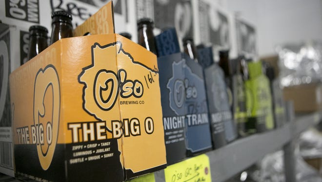 Six packs of O'so beer sit in the cooler at O'so Brewing Co. in Plover.