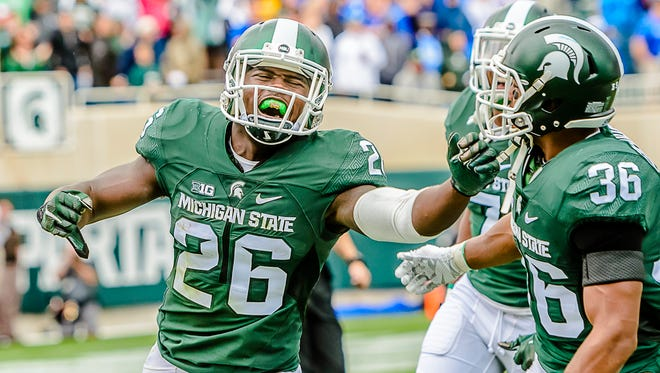 RJ Williamson ,26, of MSU celebrates after intercepting a pass meant for Ryan Reffitt of Air Force on a 3rd and goal  at the MSU 10 yard line in the 4th quarter.