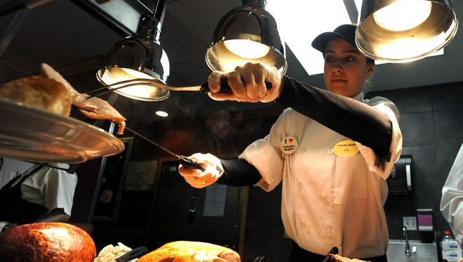 A Country Buffet employee serves turkey in this 2009 file photo.