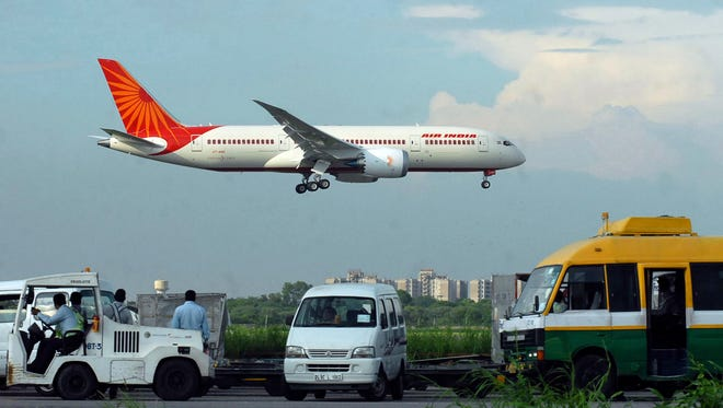 In this file photo, an Air India Boeing 787 Dreamliner prepares to land at Indira Gandhi International Airport in New Delhi on Sept. 8, 2012.