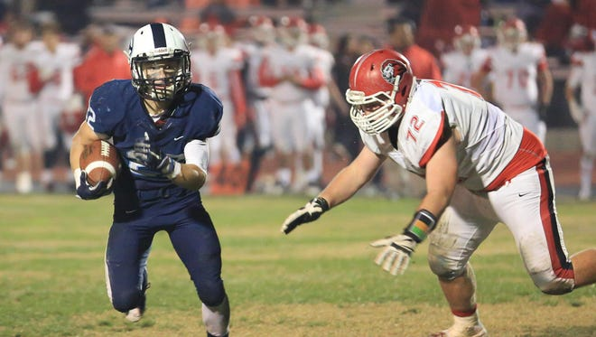 CVC running back Connor Paden charges forward against Kerman in a Central Section Division IV quarterfinal game on Nov.  20, 2015.