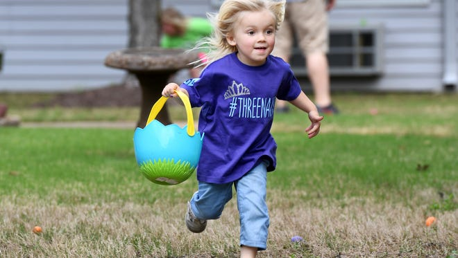 Baylin Lawrence runs to find Easter eggs hidden by residents of Elmcroft or Jackson Senior Living, Friday, April 14. Over 50 children participated to find over 2,000 plastic eggs.