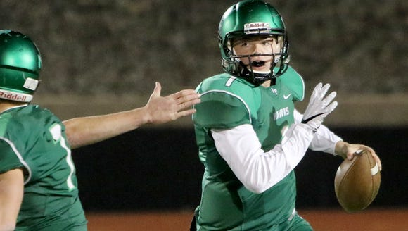 Iowa Park's Trent Green looks for a open receiver in