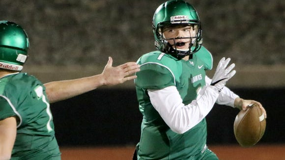 Iowa Park's Trent Green looks for a open receiver in the game against Graham Friday, Nov. 10, 2017, in Iowa Park.