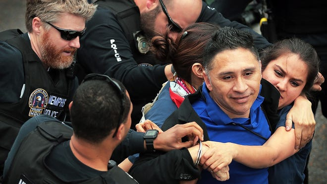 Memphis police arrest Manuel Duran, a reporter for Spanish-language media during a Memphis protest Tuesday, April 3, 2018. The original charges behind the arrest were dropped Thursday, April 5, 2018, but Duran remains in jail on an immigration hold, his defense lawyer said.