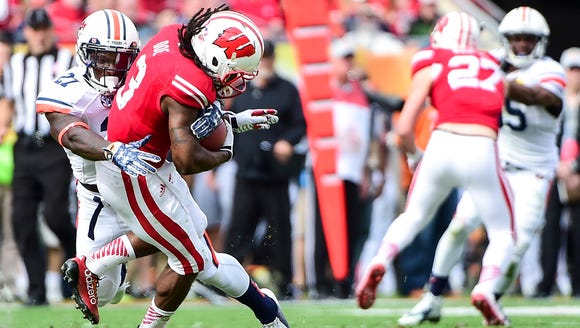 Robenson Therezie (27) with a big hit on the Wisconsin
