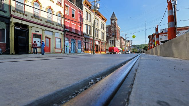 Streetcar tracks run north on Elm Street toward Findlay Market. Finding the operating money is going to require a united effort, Michael Kintner says.