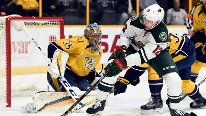 Minnesota Wild center Eric Staal (12) maneuvers the puck in front of Nashville Predators goalie Pekka Rinne (35) during the first period on Dec. 27, 2016.