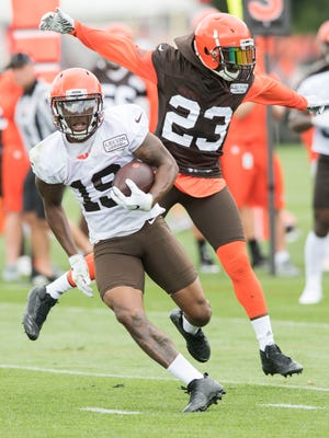 Cleveland Browns wide receiver Corey Coleman (19) runs with the ball as defensive back Damarious Randall (23) defends during training camp at the Cleveland Browns Training Complex in July.