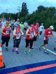 Participants in the walking division of Running on