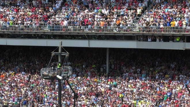 Packed paddock and paddock penthouse stands are seen during pre-race ceremonies before the 100th running of the Indianapolis 500 on May 29, 2016.