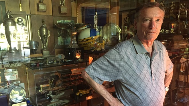 Johnny Rutherford with his trophies in his home.