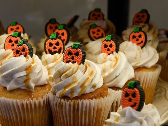 Gluten-free Halloween-themed cupcakes are on display