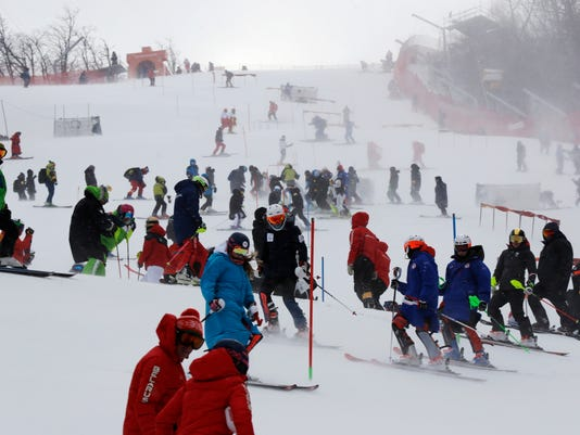 Skiers take part in an inspection of the course ahead of the women's slalom at Yongpyong alpine center at the 2018 Winter Olympics in Pyeongchang, South Korea, Wednesday, Feb. 14, 2018. (AP Photo/Luca Bruno)