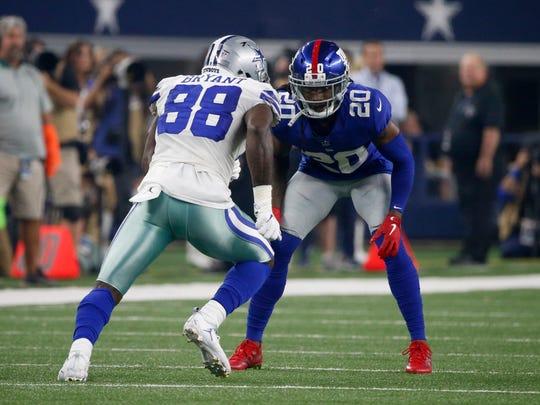 The Giants' Janoris Jenkins checks the Cowboys' Dez Bryant last Sunday.