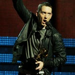 In 2009, Eminem released his comeback album 'Relapse' and quickly followed it up with 'Recovery' in 2010. Both were critical and commercial successes; they also both won best rap album Grammys. Here, Eminem holds his trophy at the awards show in 2011.