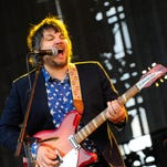 Jeff Tweedy of the band Wilco performs solo in concert with son Spencer Tweedy.