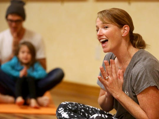 Molly Schreiber teaches a toddler yoga class at Body & Soul Wellness Center and Spa in Dubuque.