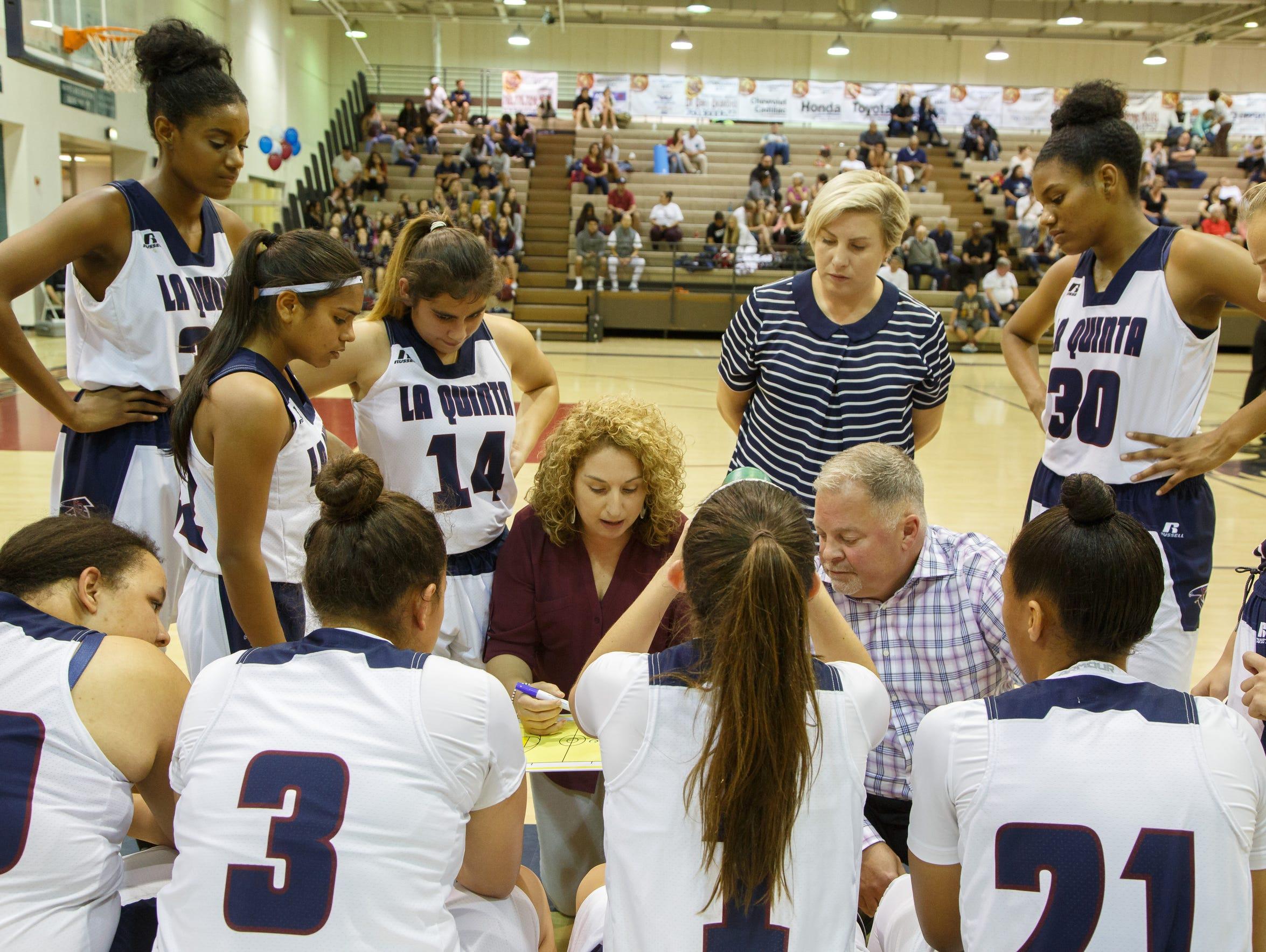 Electra Viveros, left, with assistant coaches Angela