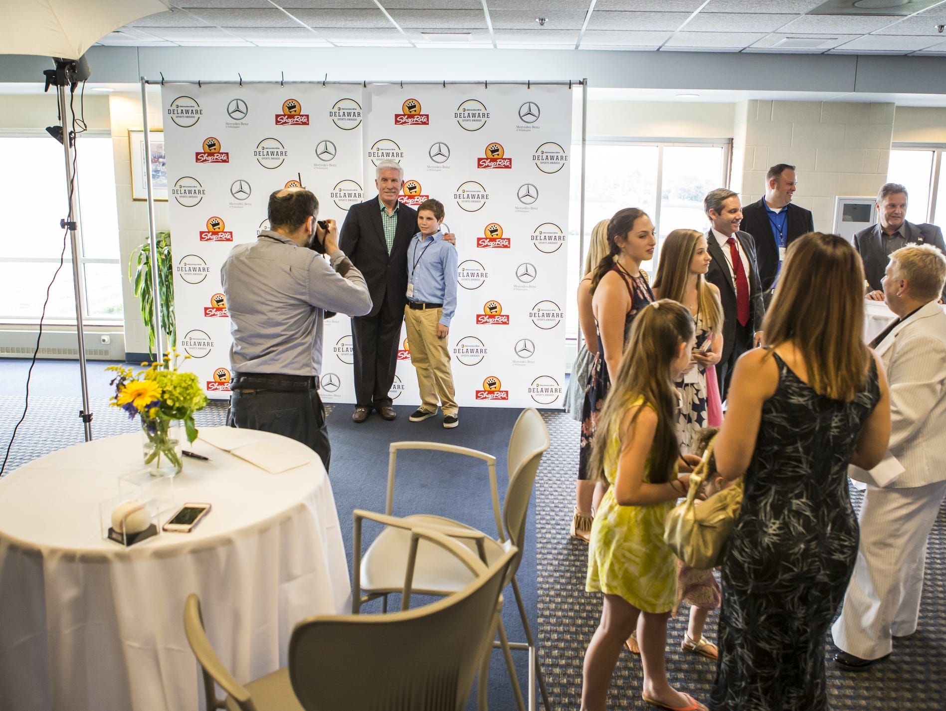 Guests get their picture taken with former Phillies third baseman Mike Schmidt at the Delaware Sports Awards banquet at the Bob Carpenter Center at the University of Delaware in Newark on Wednesday evening.