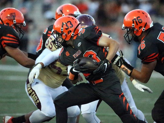 El Paso High running back Shane Rodriguez, 33, carried the ball against Andress Thursday night in Jones Stadium.