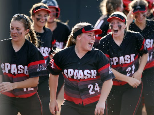 Shaylee Kluck (24) of Stevens Point celebrates Halle Pavelski's home runcwith her teammates during the third inning at the WIAA D-1 State Softball Championship at the Goodman Diamond in Madison. Stevens Point defeated Watertown 16-4.