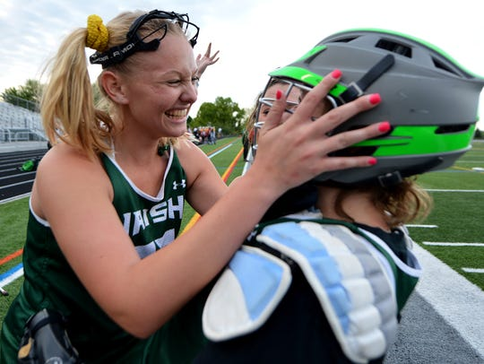 Anna Linthicum, left, and goalie Kirsten Lake celebrate