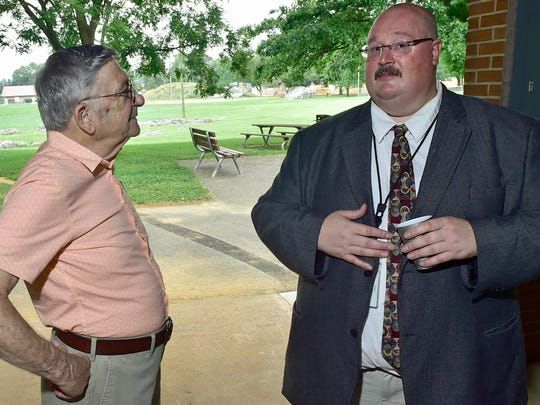 Ron Sugden, left, former Franklin County Chief of Probation, chats with current chief Dan Hoover on Thursday, July 13, 2017. A picnic to celebrate the 100th year anniversary of Franklin County Probation was held at Chambersburg Memorial Park. Sugden was chief from 1975 to 1995.