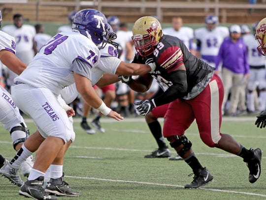 Midwestern State's Michael Nash tries to get around
