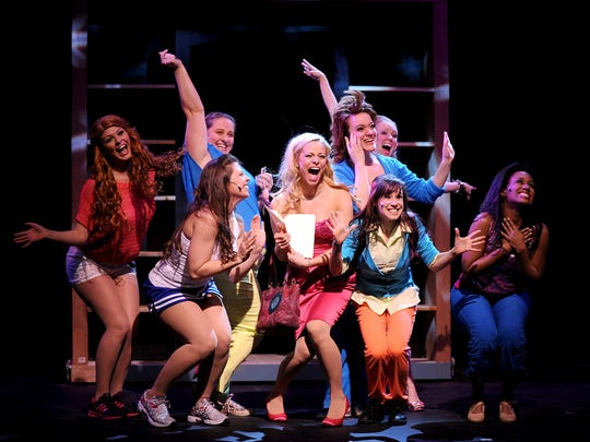 Elle Woods, center, played by Kara Dombrowski, goes shopping with her friends during a 2013 rehearsal of Midtown Arts Center's 'Legally Blonde.' Housing Catalyst plans to buy the Fort Collins performance venue and turn the site into adaptive housing for homeless residents.