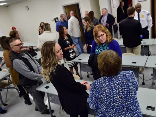 Officials and visitors attend a press conference, Friday, January 12, 2018. District Attorney Matt Fogal lead a press conference with all Franklin County Chiefs of Police, Overdose Drug Task Force, etc to discuss the state of the epidemic/new initiatives today at the county's Public Safety Training Center, south of Chambersburg.