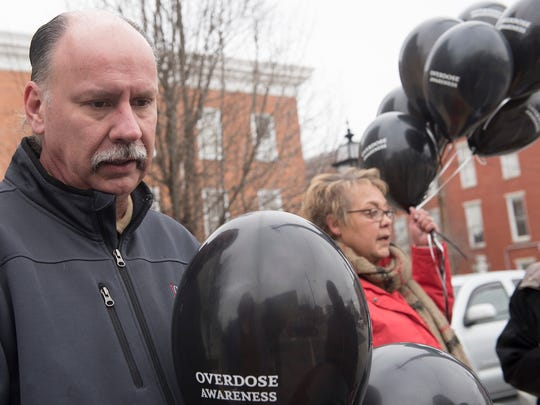 Mike Straley and Vicki Rhodes, both parents who lost daughters to an opioid overdose, placed black balloons in downtown Greencastle in March as part of an effort to raise awareness for drug addiction and overdose.
