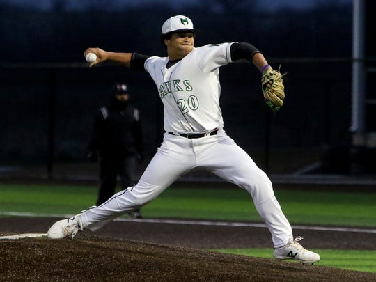 Iowa Park's Chris Dickens pitches against Vernon Tuesday, March 27, 2018, in Iowa Park.