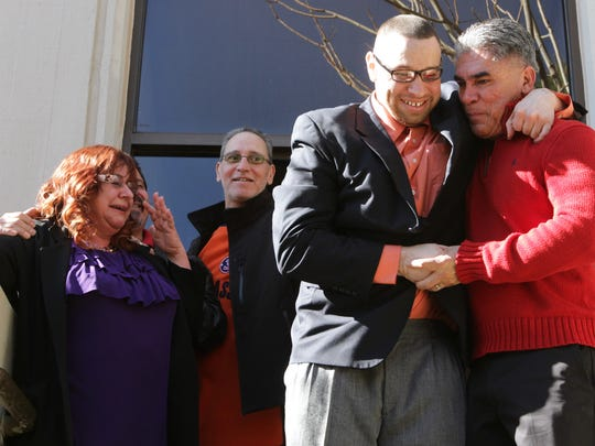 Daniel Villegas is shown on Jan. 13, 2014, the day he was released from the El Paso County Jail, with supporter John Mimbela, shortly after bond was posted. Villegas' mother looks on.