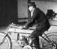 Albert Champion is seated on an Orient tricycle holding a French engine, which was state-of-the-art in 1900.