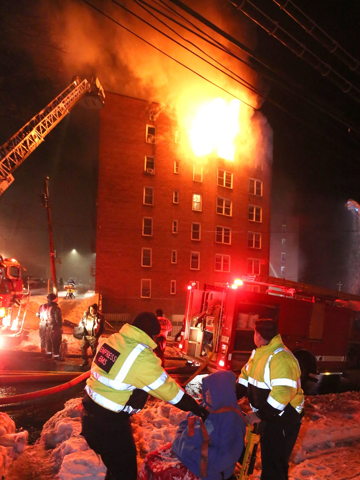 Empress ambulance personnel remove residents as fire