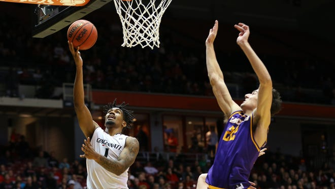 Cincinnati Bearcats guard Jacob Evans (1) takes a shot against Lipscomb Bisons forward Eli Pepper (22) in the first half at Fifth Third Arena.