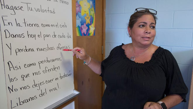 Lighthouse Private Christian Academy teacher, Tessie Avila, right, teaches students in both English and Spanish. This is the private school's first year offering a bilingual curriculum and has more than 70 students enrolled in the program.