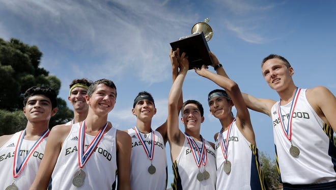 The Eastwood cross country team celebrates their District 1-6A District Cross Country Championship last month at the Chamizal National Memorial.