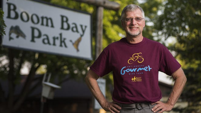 Neenah's Dave Meyer has worked with Best Friends of Neenah-Menasha for 25 years, both as a mentor and as a volunteer with the group's annual Gourmet Bike tour that passes through Boom Bay Park in Larsen.