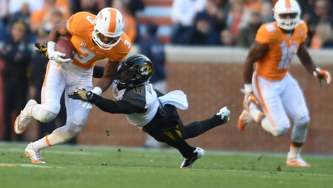 Missouri defensive back Aarion Penton tries to tackle Tennessee wide receiver Josh Malone (3) on Nov. 19, 2016.
